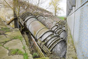 Outlet pipes of a water pumping station. Pipes of large diameter