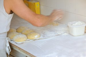 Baker preparing bread dough