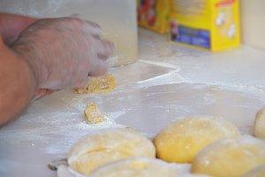 Baker preparing bread dough detail
