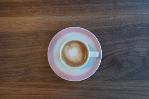 Cappuccino coffee on wood table