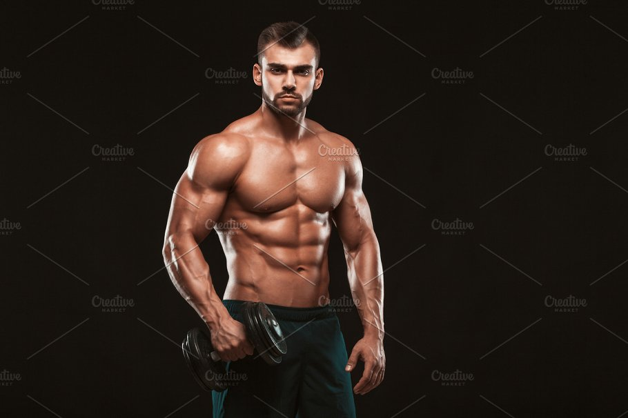 Handsome Power Athletic Man In Training Pumping Up Muscles With