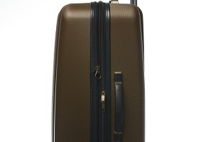 One large plastic brown suitcase