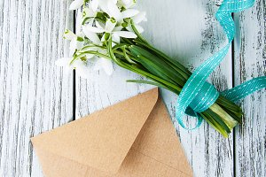 Bouquet of snowdrops with envelope