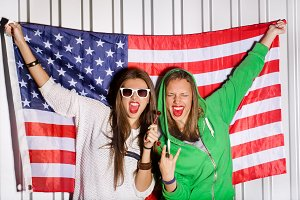 girls holding national usa flag