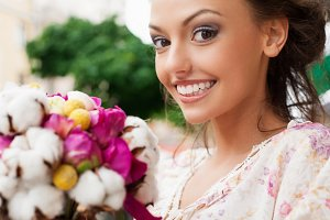 young woman with bouquet flowers