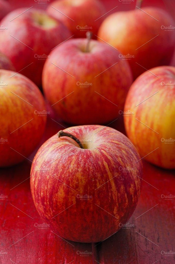 Apples on Red Wood. Vertical - Food & Drink