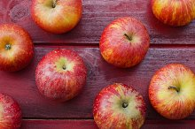 Apples on Red Wood