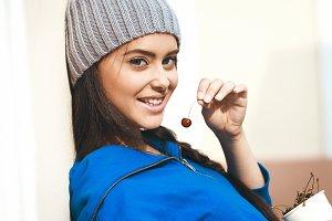 Girl eating cherry