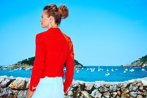 traveller woman in Donostia Spain looking into the distance