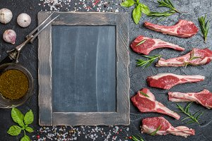 Raw lamb chops with salt, pepper, rosemary