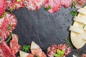 Italian ham, prosciutto and salami with melon.