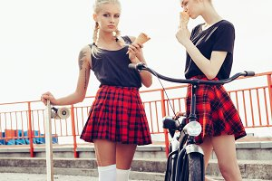 Two Sporty Young Beautiful Girls Eating Ice Cream