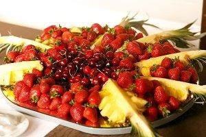 Ananas, cherries and strawberries