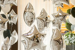 Silver baloons in the room