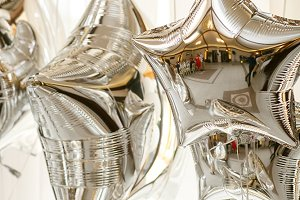 Reflects in the silver balloons