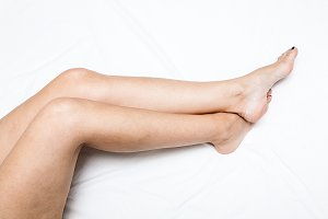 Shaved and smooth woman's long legs.