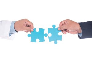 science man hand holding jigsaw