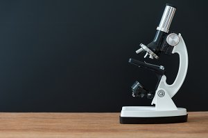 microscope on wooden table