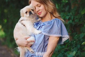 young beautiful girl with pekingese