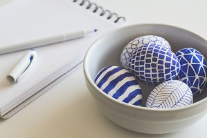 Blue painted easter eggs and notepad