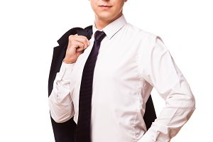 Young handsome businessman is holding a jacket in his one hand and the other hand in his pocket. portrait isolated on white background