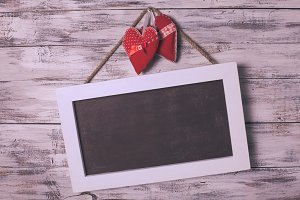 Blank chalkboard and hearts