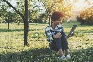 Ebony girl with digital tablet