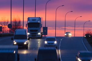 sunrise with vehicles in motion