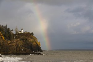 Rainbow over Lighthouse on Ocean
