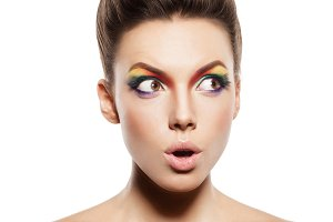 female face with rainbow make-up