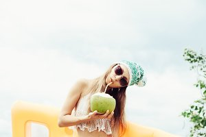 woman in bikini with coconut
