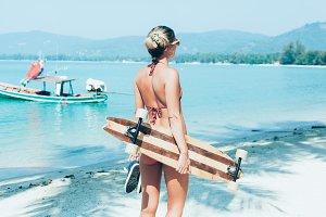 Sporty woman with longboard