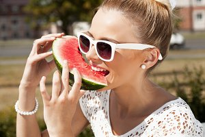 woman biting watermelon