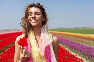 woman in the red tulip field