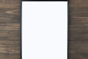 Black wooden frame on brown background.