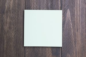 Paper note on wooden background.