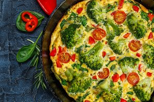 Frittata with broccoli in a frying pan.