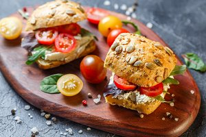 Two fresh sandwiches with cherry tomatoes