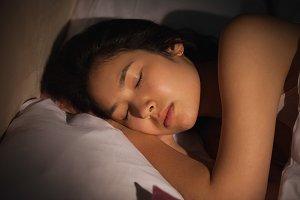 Young asian woman sleeping peacefully at night