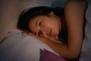 Young asian woman suffering from insomnia