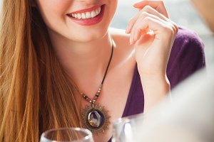 Cheerful woman having glass of wine with her boyfriend