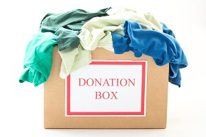 Cardboard donation box with clothes