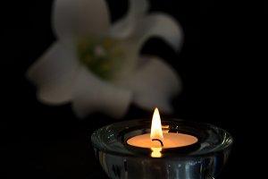 Tea light candle lighting in glass holder
