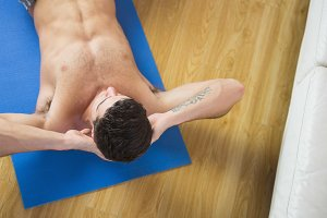 Overhead view of attractive man doing sit ups