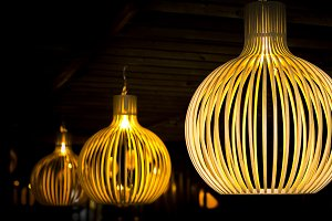 Cozy modern wooden lamps at night