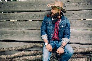 Bearded cowboy with a gun.