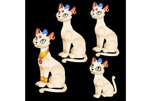 Egyptian figurines of white cats