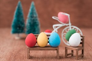easter eggs sitting on a chair