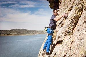 man practicing climbing