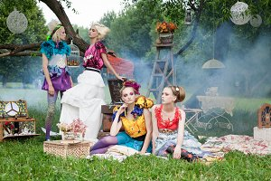 women on picnic in fairy forest